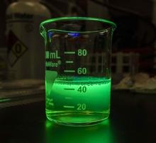 Beaker containing green fluorescent protein